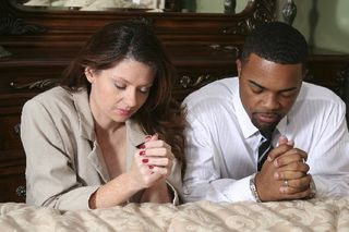 Couple-praying-mixed-MED